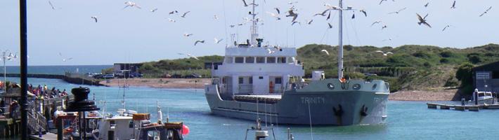 "The boat ""Trinity"" entering the Littlehampton Harbour."